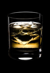 Glass of whisky on a black background