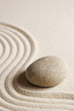 Fototapety Stone on raked sand