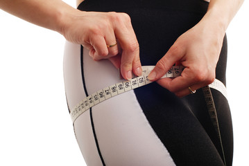 Woman measuring waist detail - isolated