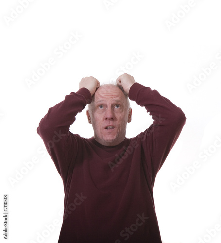 Man Pulling His Hair Out