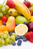 Fototapety Viele Sorten von Früchten auf weißem Hintergrund