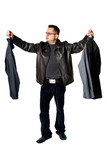 Isolated Young Man Choosing Between Two Shirts poster