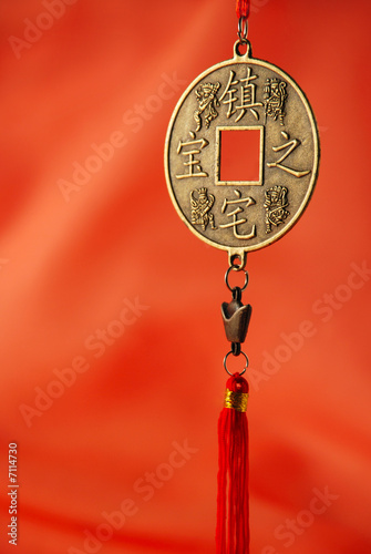 Oriental medallion on the red silk background