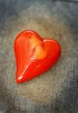 Red ceramics heart on denim cloth poster