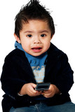 Worried Little Toddler Child holding a cell phone