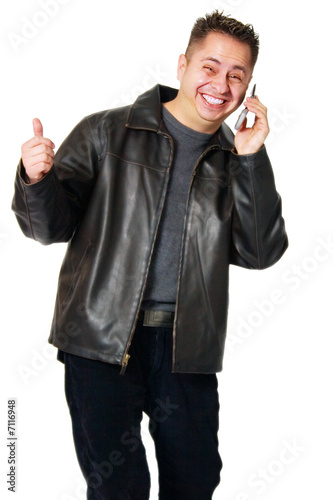 Isolated young adult talking on the phone giving thumb up