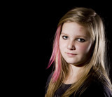 Young proud teenage girl posing on black background poster