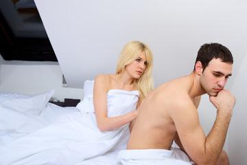 couple breaking up in bedroom, focus on female