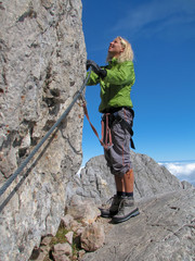 woman climbing on ferrata 1