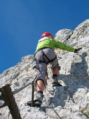 woman climbing on ferrata 3