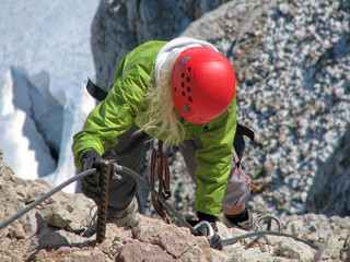 woman climbing on ferrata 4