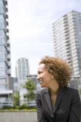 Business woman standing outside office buildings