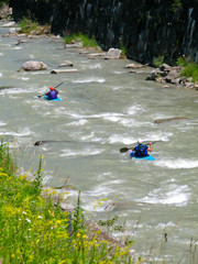 two kayakers in alpine wildwater