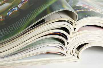 colourful glossy magazines the opened pages