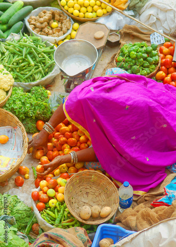 Indian lady in Sari surrounded by food
