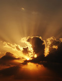 dramatic sundown scene with dark clouds and rays poster