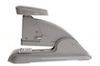 Vintage grey stapler, side view.