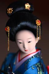 Japanese porcelain doll in blue kimono
