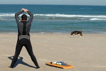 Surfer making warm exercises