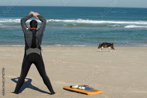 Surfer making warm exercises