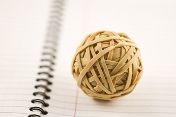 Rubber band ball on lined notebook paper