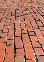 Weathered red paver bricks