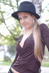 Portrait of a beautiful young lady with black hat