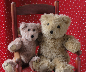 old teddy bears in a red chair