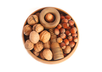 Walnuts and hazelnts in a wooden bowl