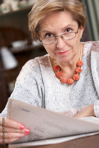 Mature woman with newspaper