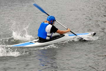 Man racing in kayak