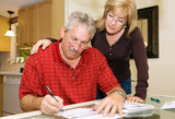 Mature Couple - Signing Paperwork poster