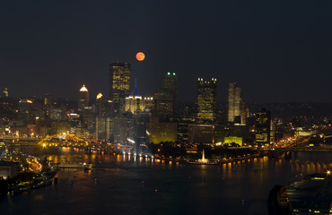 Full Moon over City buildings