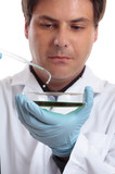 Scientist or researcher in laboratory.  Focus pipet dish poster