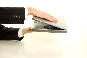 Businessman is closing his laptop