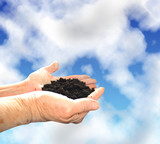 Soil in hands, sky wiht clouds poster