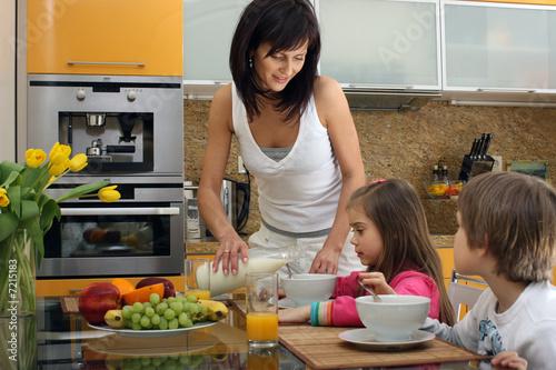 Beautiful mother serving breakfast 2