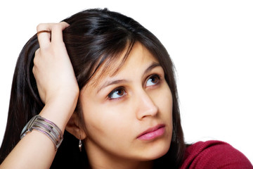 Thoughtful Worried Young Hispanic Woman Holding her Head
