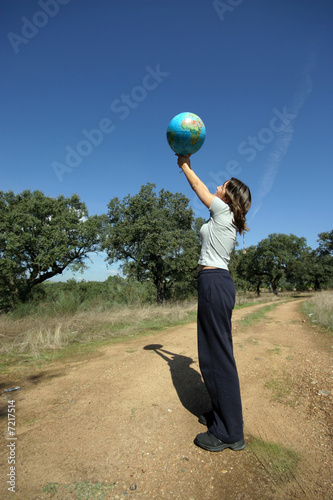 girl holding earth