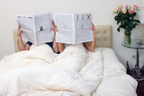 Couple reading newspapers 2