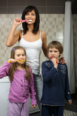Beautiful mother brushing teeth