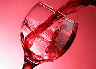 Close-up of pouring red wine