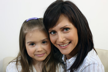 Beautiful mother and daughter portrait 3