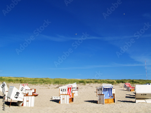 canvas print picture Leere Strankörbe am Sylter Strand