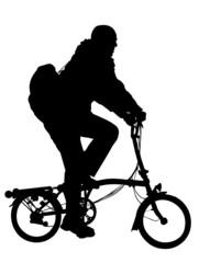 man riding modern foldable bicycle