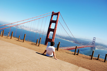 Young boy looks at the Golden Gate Bridge