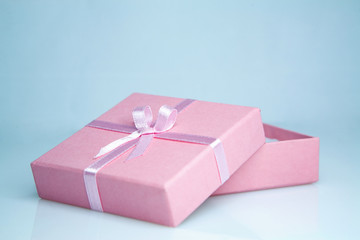 box gift with a pink ribbon