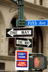 Fifth Avenue sign in pedestrian crossong, midtown Manhattan, NYC