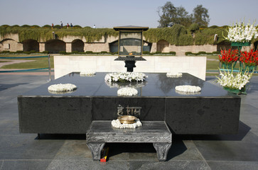 gandhi's memorial tomb stone in rajghat, delhi, india