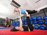 Flexible girls in fitness studio